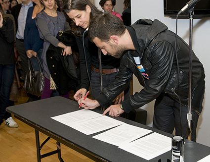 Nina Katchadourian and Ahmet Öğüt, AHHA. Signing of contracts at Pratt Manhattan Gallery, New York