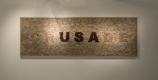 Willem Boshoff Crusade (2011) Panel with wood, sand, glass and pigment; 50.5 x 98.5 inches Installation view at Goodman Gallery, Johannesburg Photo: John Hodgkiss, courtesy of the artist and Goodman Gallery.