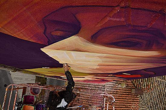 FIG 3. INTI writing 15M on the scarf of his Don Quixote, Quintanar de la Orden 2014. Photo: Paula Jiménez, CULM